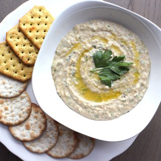 A delicious and easy white bean dip recipe with garlic and fresh parsley. Vegan and gluten-free, this easy white bean dip is a party essential.