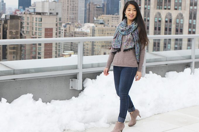 A cute scarf, light sweater, jeans, and booties make for the perfect transitional outfit.