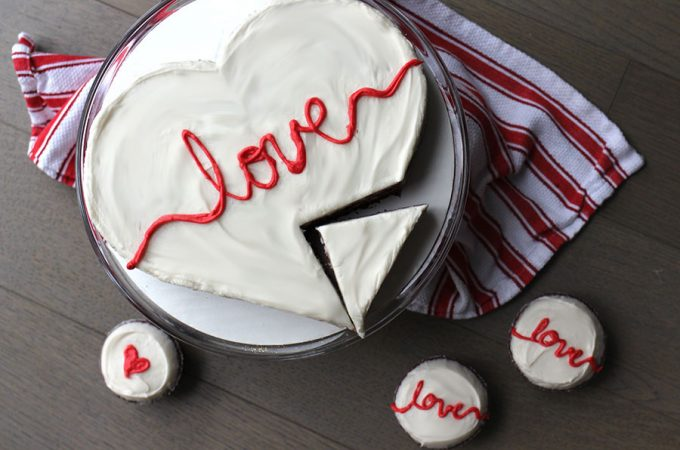 A heart-shaped vegan red velvet cake that is moist, flavorful, and delicious! Features coconut oil and is egg-free, dairy-free, butter-free.