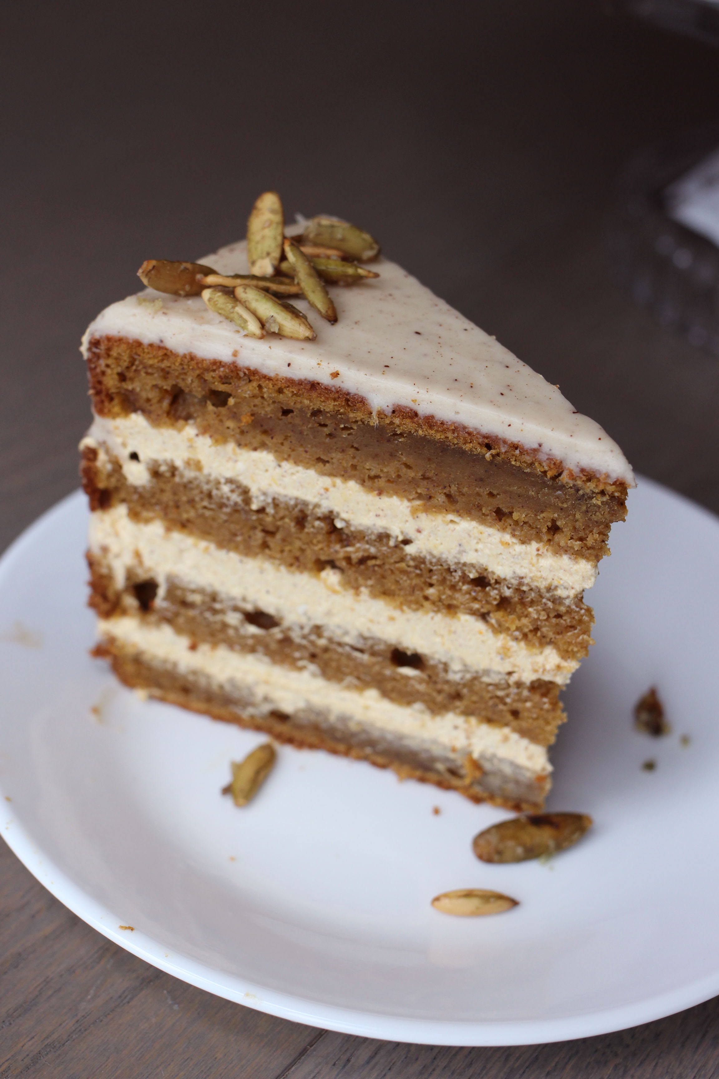 An amazingly decadent four-layer pumpkin spice cake with a no-bake pumpkin cheesecake filling, topped with a to-die-for brown butter cream cheese frosting.