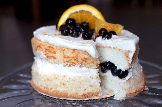 A miniature take on a delicious, light and airy angel food cake, highlighted with notes of citrus, and garnished with fresh fruit and whipped cream.